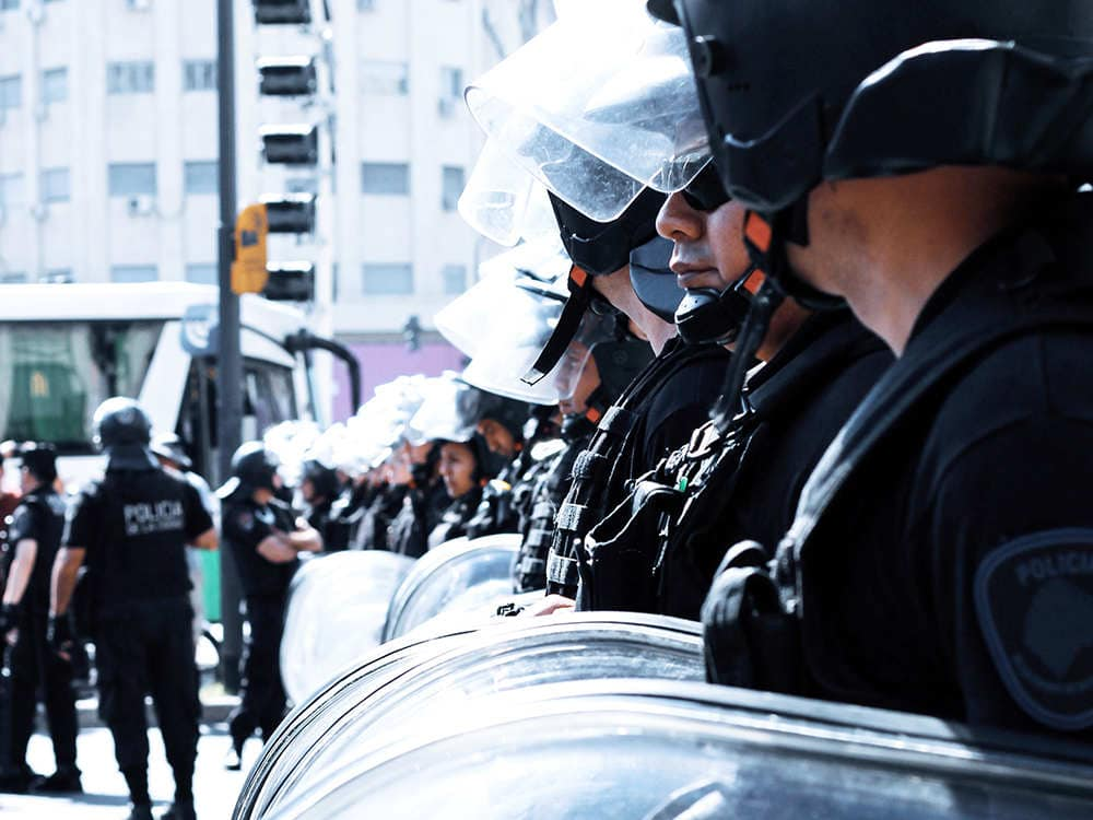 police officer takes riot shields