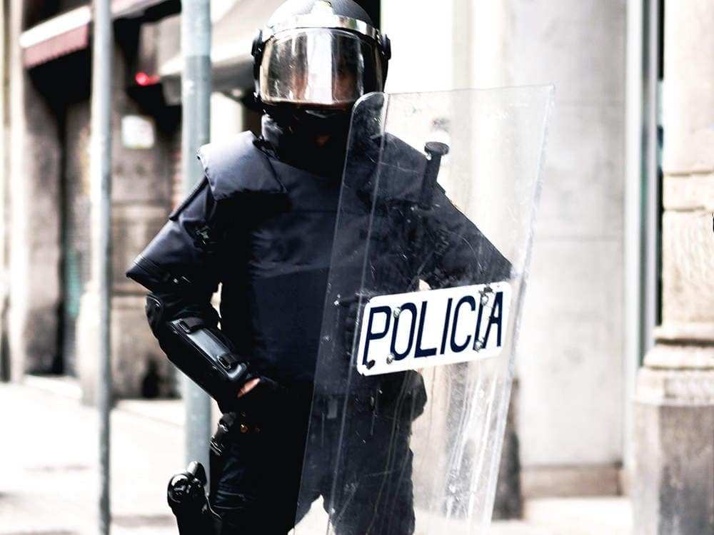 French police officers use riot shield for riot control
